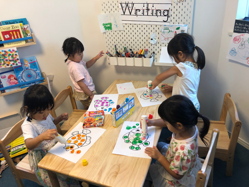 Kindergarten Students Painting Art at the English Writing Table